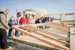 Self-Help Enterprises-Families raising the walls of their new home 2014